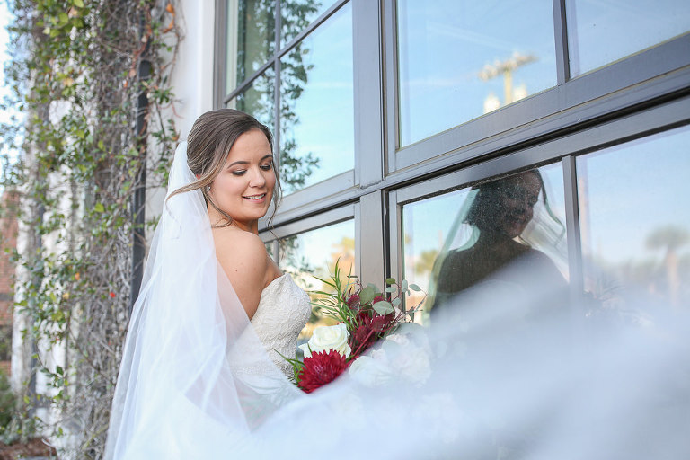 Florida Bride Creative Wedding Portrait with Cathedral Length Veil Blowing in Wind | Tampa Bay Wedding Photographer Lifelong Photography Studios | Tampa Bay Wedding Hair and Makeup Team Renee Michele the Studio