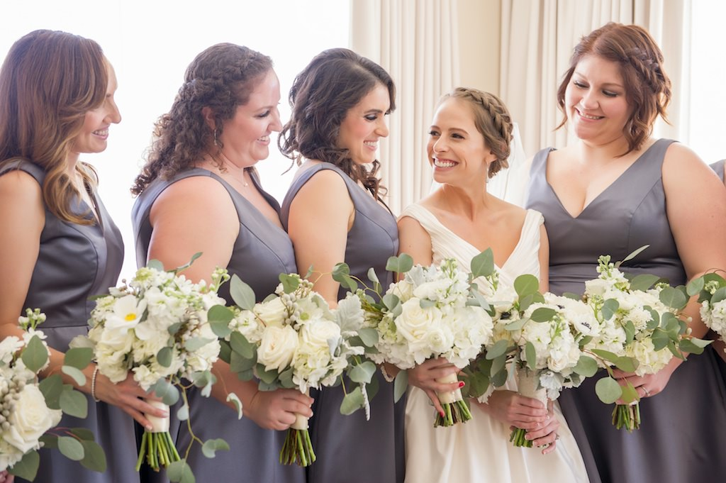 Bride in Classic Makeup with Braid and Purple Grey Matching Bridesmaid Dresses with White Wedding Bouquet with Greenery | Clearwater Beach Wedding Photographer Andi Diamond Photography | Hair and Makeup Artist Femme Akoi Beauty Studio