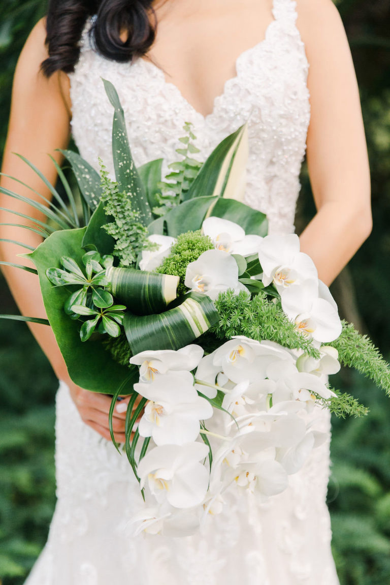 Modern, Tropical Inspired Green and White Bridal Bouquet, Palm Fronds, Monstera leaves, Cascading Orchids Flowers by Tampa Bay Wedding Florist Bruce Wayne Florals