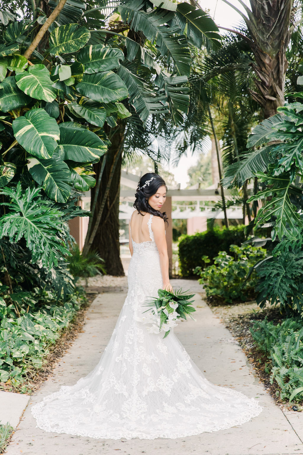 Modern, Tropical Florida Bridal Portrait, Green and White Bridal Bouquet with Palm Fronds, Monstera leaves, Boho Inspired White Martina Liana Wedding Dress with Open Back | Tampa Bay Florist Bruce Wayne Florals | Florida Resort Waterfront Wedding Venue The Vinoy Renaissance St. Petersburg Resort & Golf Club | Hair and Makeup Artist Michele Renee The Studio