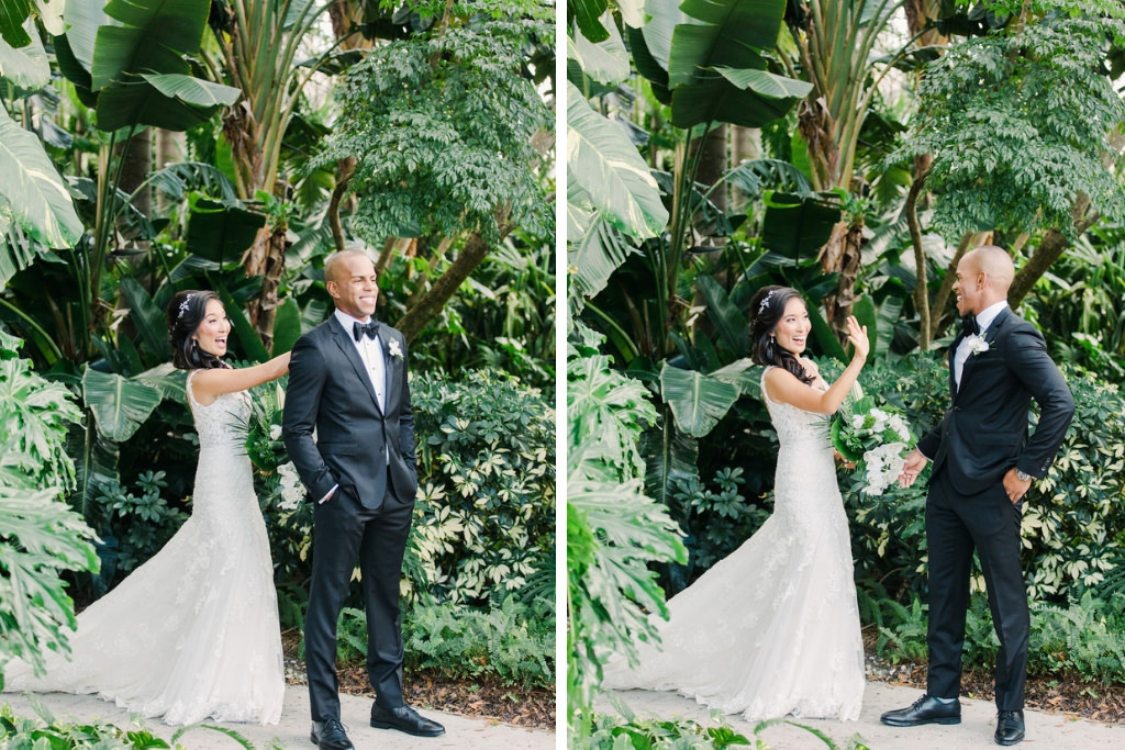 Modern Bride and Groom First Look Reaction in Tropical Green Garden, White Orchid Cascading Floral Bouquet | Florida Waterfront Resort Wedding Venue The Vinoy Renaissance St. Petersburg Resort & Golf Club | Tampa Bay Florist Bruce Wayne Florals