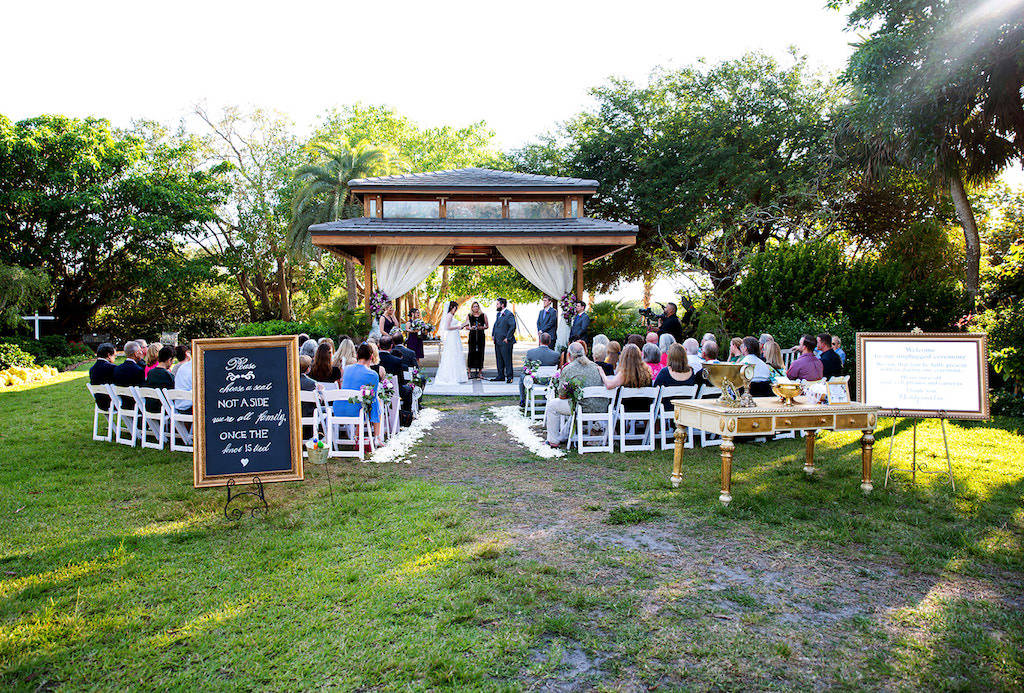 Elegant, Classic Garden Gazebo Wedding Ceremony Decor, White Draping, Pick a Seat Not a Side Chalkboard and Gold Frame Sign, Gold Vintage Furniture Accent Pieces | Sarasota Wedding Planner Laura Detwiler Events | Wedding Venue Marie Selby Botanical Gardens
