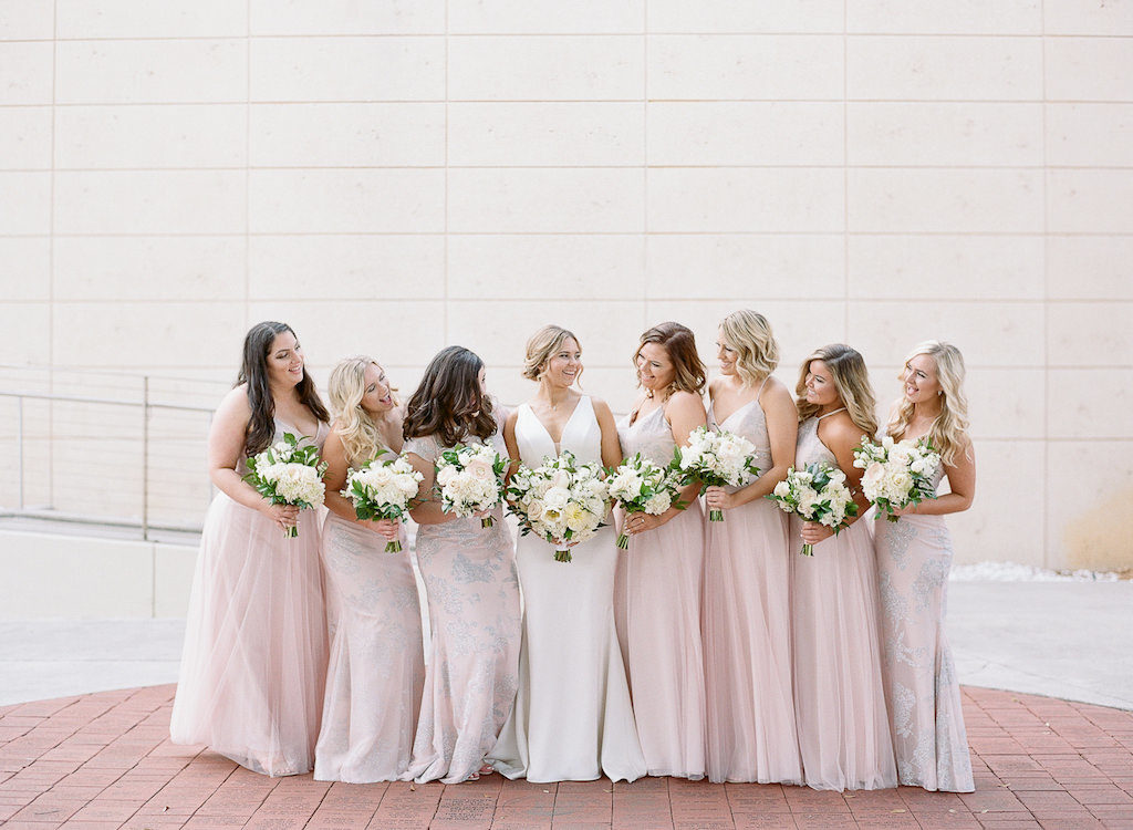 Tampa Bay Bride and Bridesmaids in Hayley Paige Mix and Match Blush Pink Bridesmaids Dresses Holding Classic Garden Inspired White, Ivory, Blush Pink, and Greenery Floral Bouquets