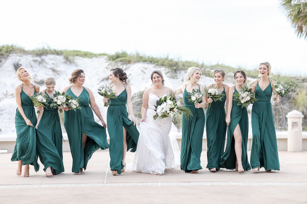 Clearwater Beach Florida Bride and Bridesmaids in Matching Green Dresses Holding Greenery and White Floral Bouquets, Bride in Spaghetti Strap Fitted Lace V Neckline Wedding Dress with Rhinestone Belt   Tampa Bay Wedding Photographer Lifelong Photography Studios