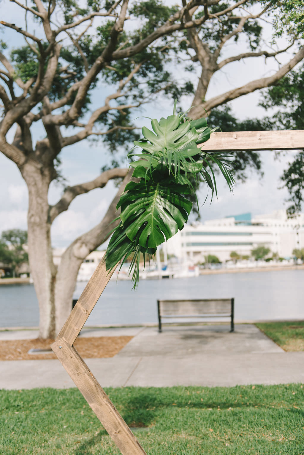 Modern, Simple Outdoor Waterfront Wedding Ceremony Decor, Geometric Wooden Arch with Tropical Monstera Palm Leaves   Wedding Photographer Kera Photography   St. Petersburg Wedding Venue The Poynter Institute