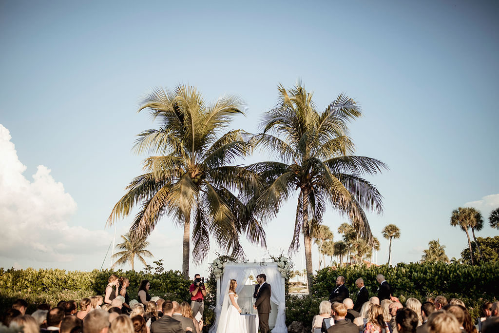 Florida Classic Bride and Groom Exchanging Vows Wedding Ceremony | Waterfront Wedding Venue The Resort at Longboat Key Club