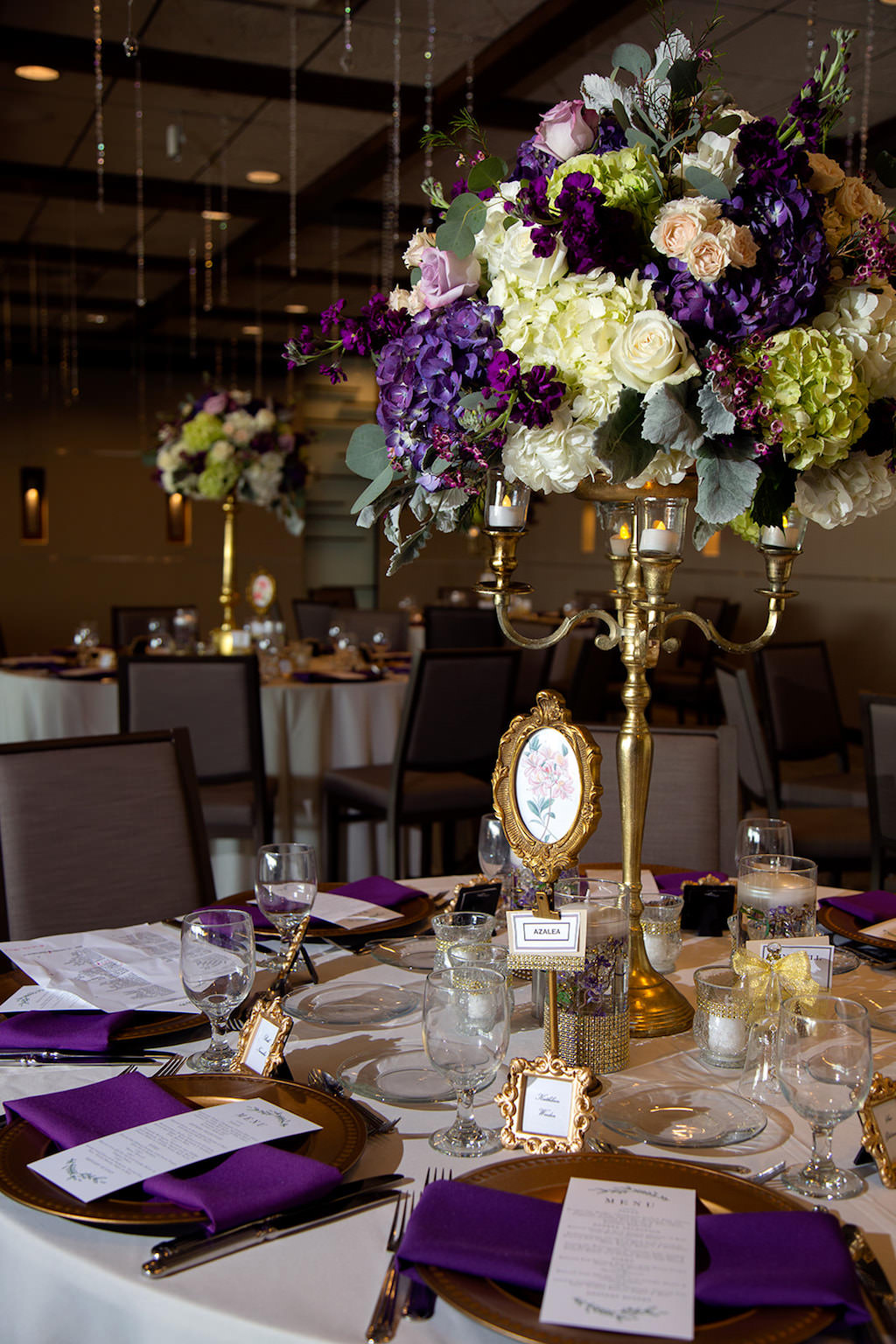 Elegant, Classic Vintage Garden Inspired Wedding Reception Decor, Tall Centerpieces, Gold Candelabra, Lilac, Purple, Green Hydrangeas, Blush Pink and Greenery Floral Arrangement, White Table Linen, Purple Napkins, Vintage Gold Frame Place Cards, Crystals Hanging From Ceiling | Sarasota Wedding Planner Laura Detwiler Events