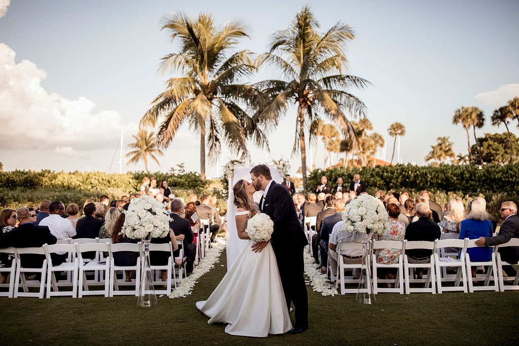 Classic, Formal Florida Bride and Groom Wedding Ceremony Exit Recessional Kiss   Waterfront Wedding Venue The Resort at Longboat Key Club