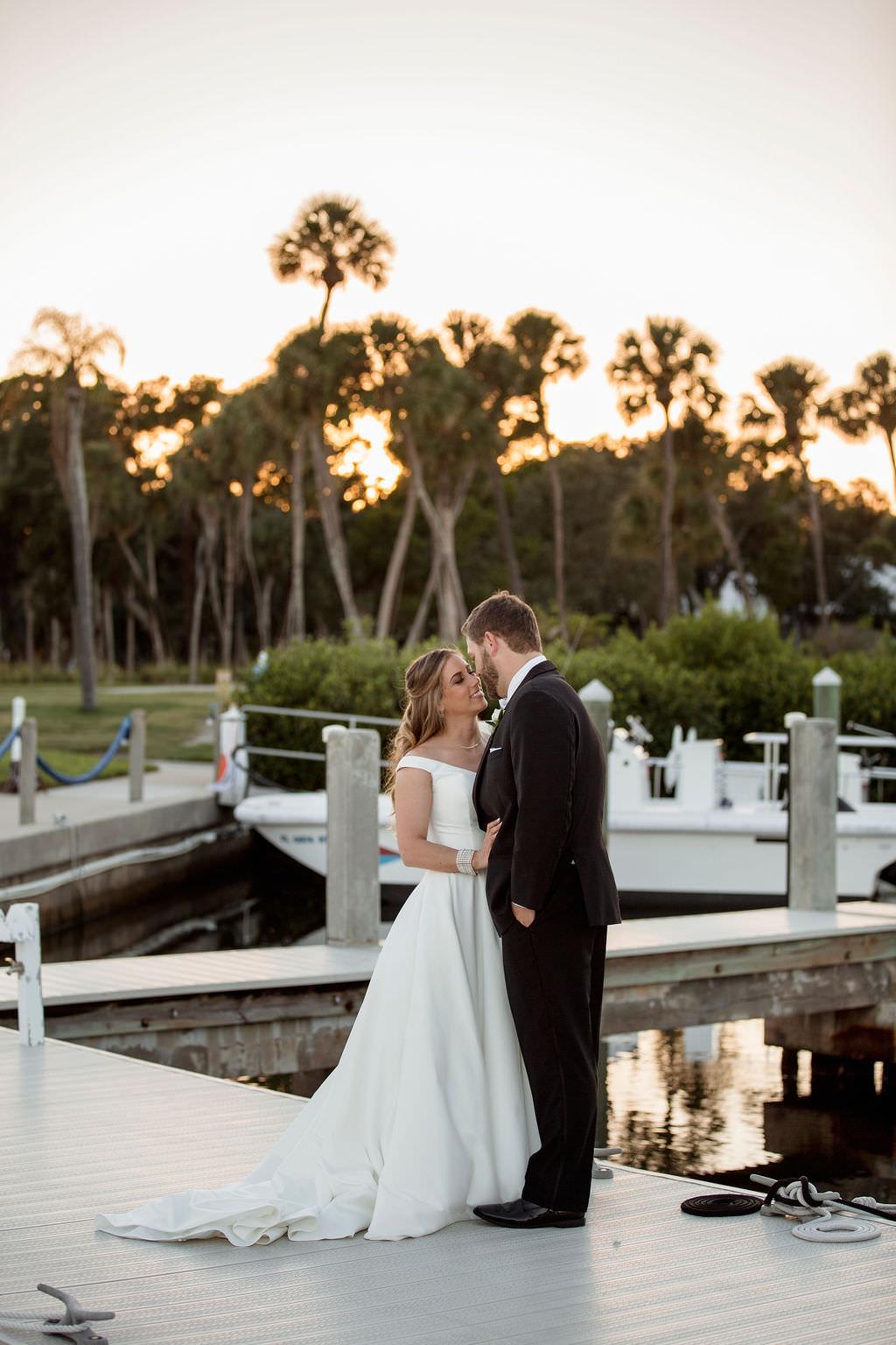 Florida Bride and Groom Boat Dock Sunset Waterfront Wedding Portrait   Waterfront Wedding Venue The Resort at Longboat Key Club