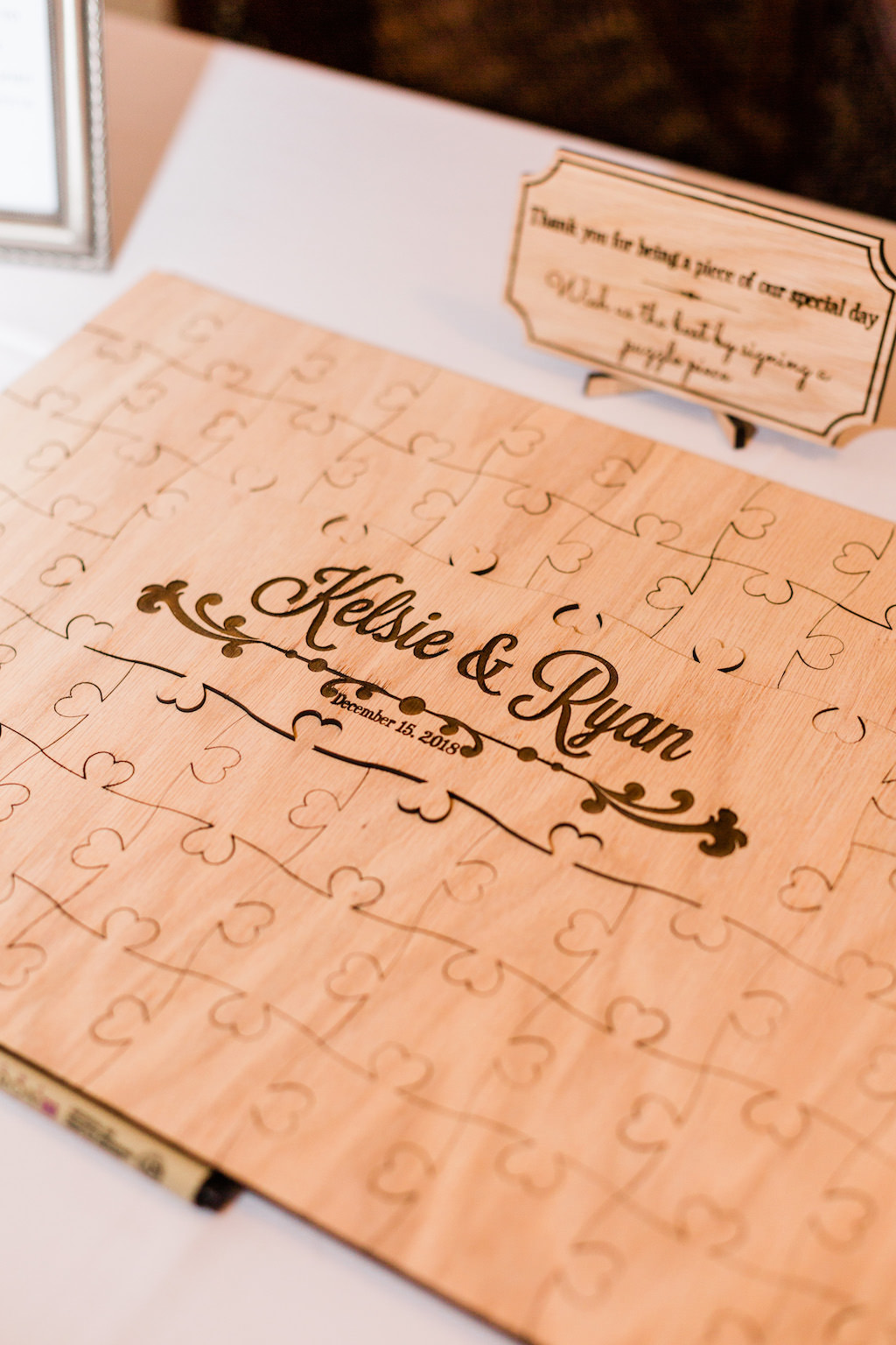 Creative, Unique Customized Wooden Puzzle Piece Guest Book at Clearwater Wedding Reception