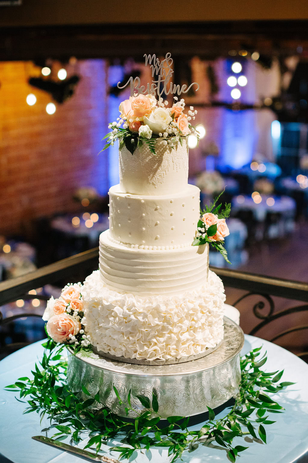 Elegant, Four Tier, White Buttercream Cake, With Multi Textured Layers, Peach Florals, Babies Breath, Greenery, Custom Mr. and Mrs. Cake Topper | Downtown St. Pete Historic Wedding Venue NOVA 535