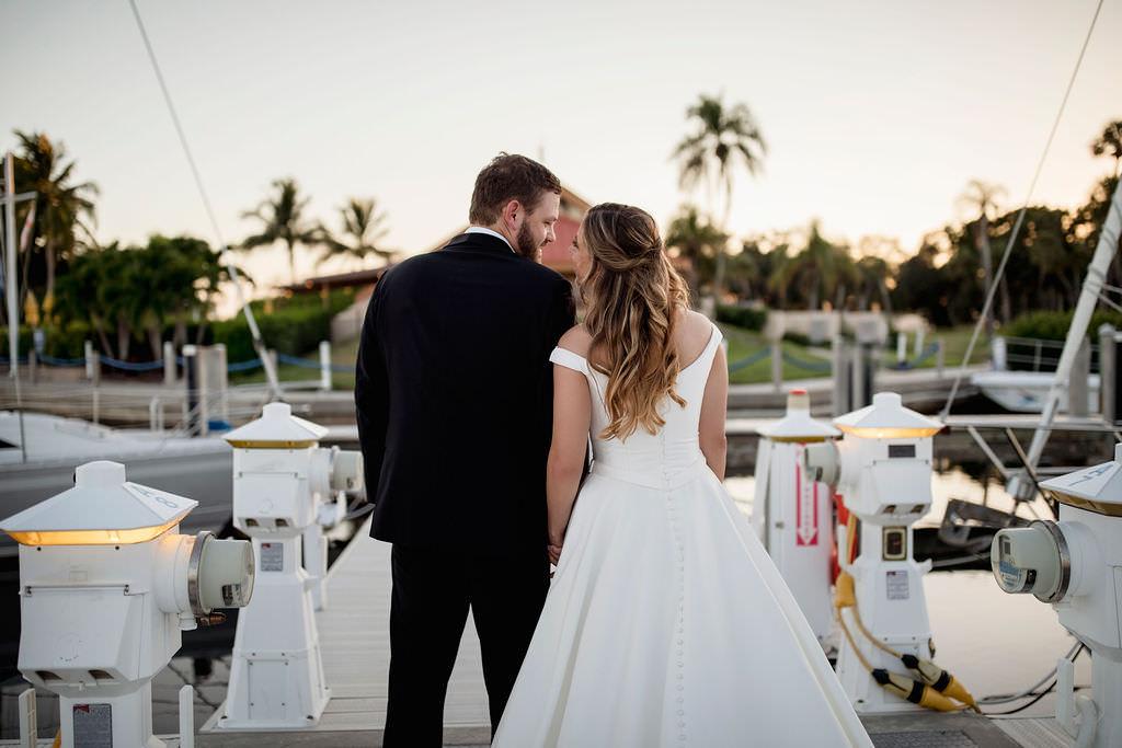 Florida Bride and Groom Boat Dock Sunset Wedding Portrait   Waterfront Wedding Venue The Resort at Longboat Key Club