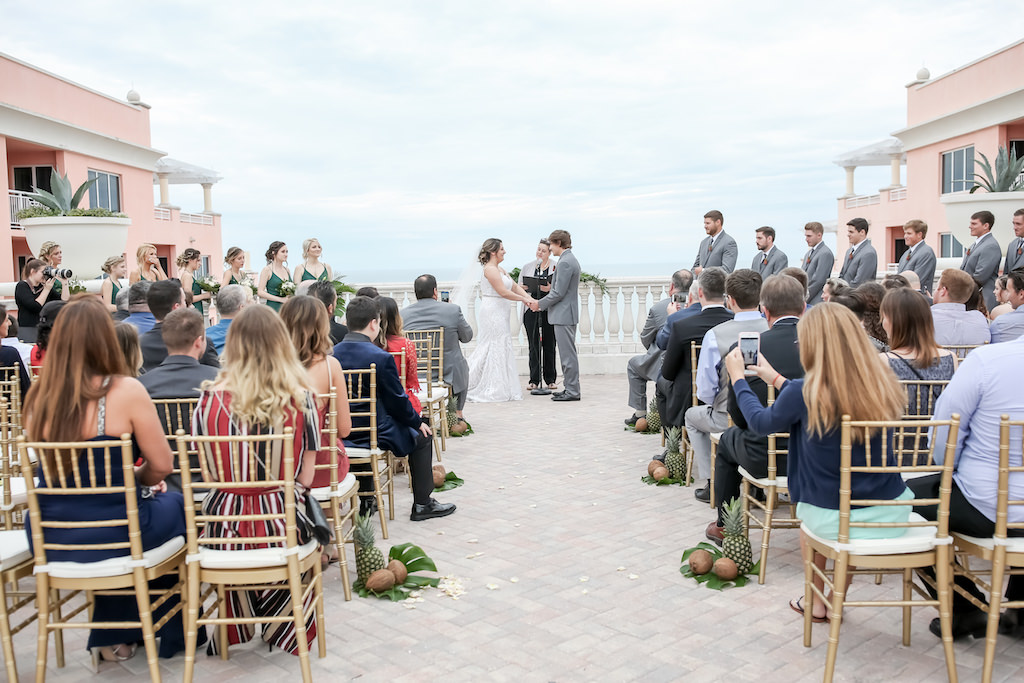 Tropical Elegant Wedding Waterfront Rooftop Ceremony Bride and Groom Exchanging Vows   Tampa Bay Wedding Photographer Lifelong Photography Studios   Florida Hotel Wedding Venue Hyatt Regency Clearwater Beach