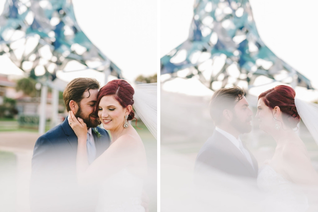 Creative Florida Bride and Groom Wedding Portrait with Bride's Cathedral Length Veil Blowing in Wind Outside with Art Sculpture   St. Pete Wedding Photographer Kera Photography   St. Pete Wedding Venue The Poynter Institute