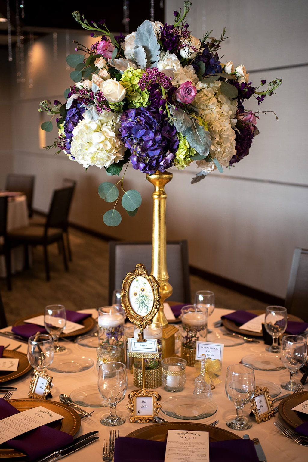 Elegant, Classic Vintage Garden Inspired Wedding Reception Decor, Tall Centerpieces, Gold Candelabra, Lilac, Purple, Green Hydrangeas, Blush Pink and Greenery Floral Arrangement, White Table Linen, Purple Napkins, Vintage Frame Place Cards | Tampa Wedding Planner Laura Detwiler Events