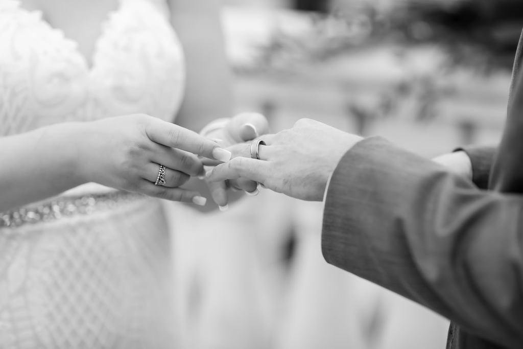 Bride and Groom Exchanging Wedding Rings During Ceremony   Tampa Bay Wedding Photographer Lifelong Photography Studios
