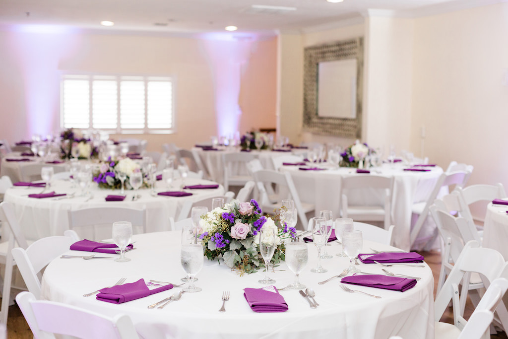 Minimalist, Garden-Inspired Wedding Decor and Reception, Round Tables with Low Floral Centerpieces with Ivory, Pink, White and Purple Flowers, Silver Accents | Tampa Bay Waterfront Wedding Venue Beso Del Sol