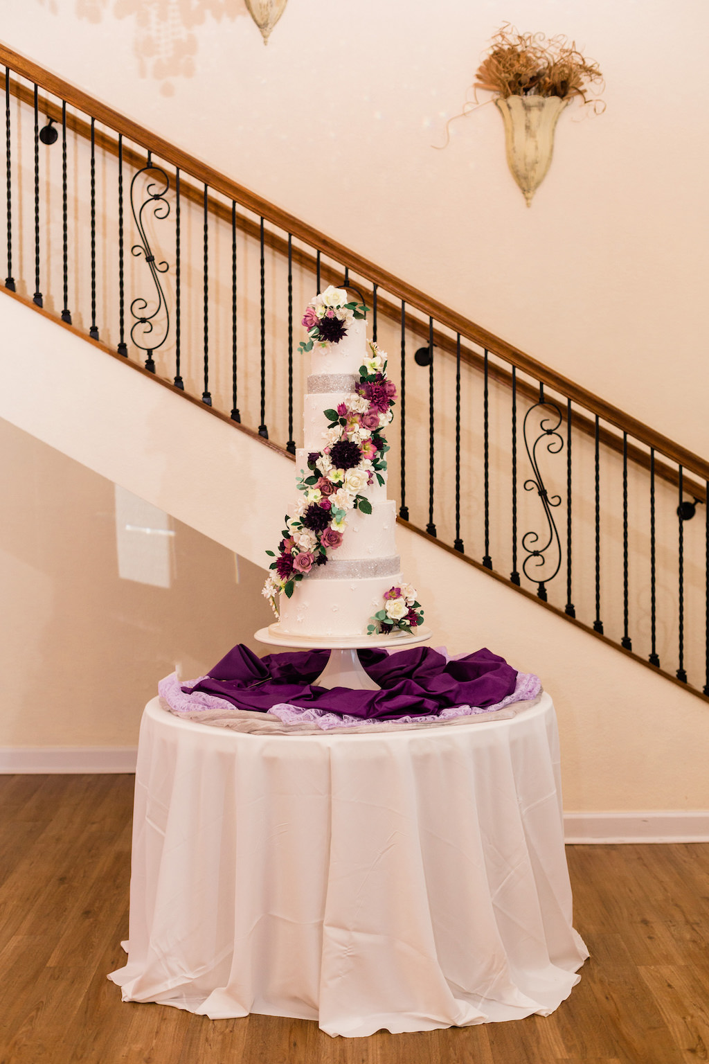Elegant, Five Tier White Wedding Cake with Lush Edible Floral Accents, White, Purple, Pink, Ivory Flowers with Silver Accents | Modern Tampa Bay Waterfront Wedding Venue Beso Del Sol