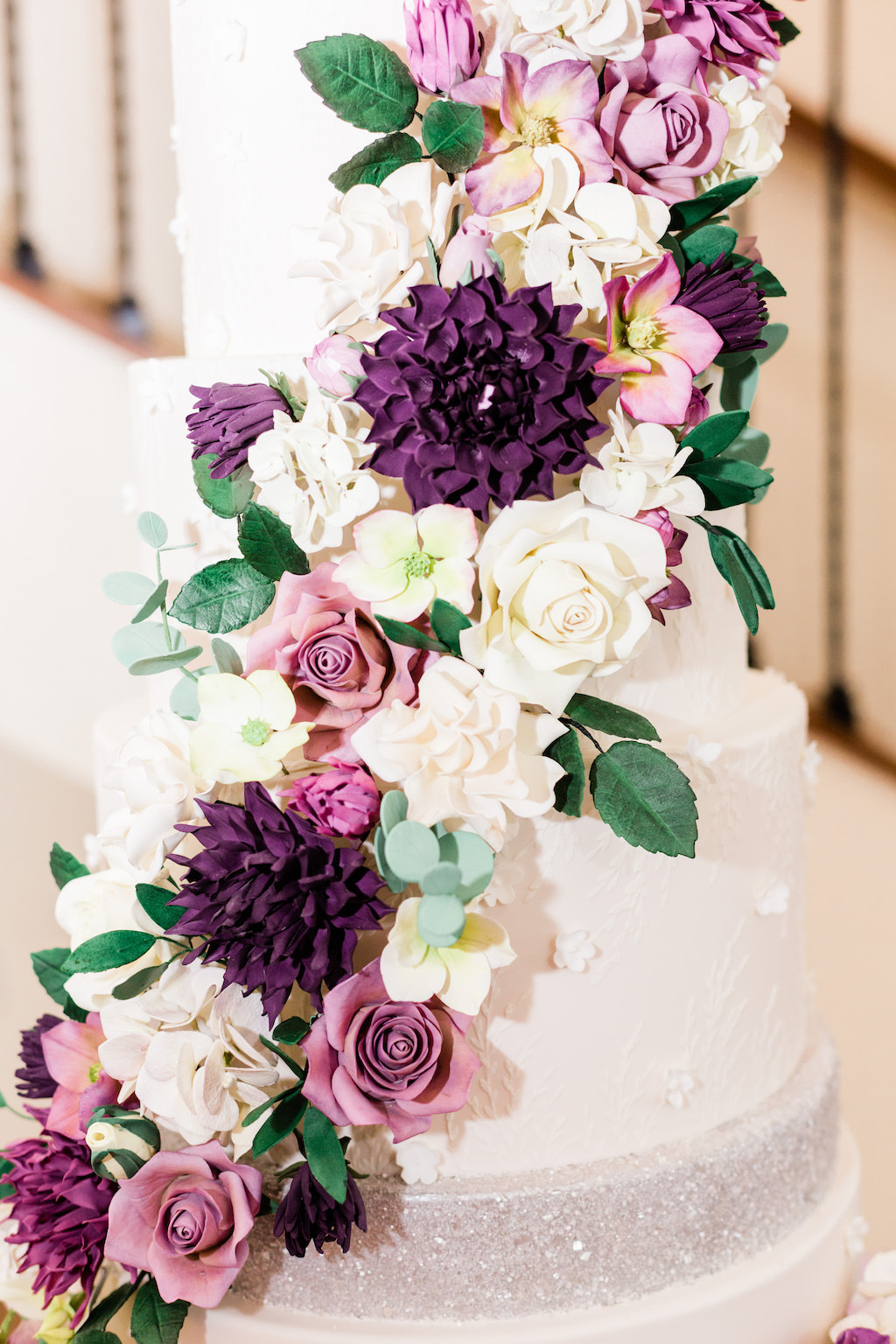 Elegant, White Wedding Cake with Lush Edible Sugar Floral Accents, White, Purple, Pink, Ivory Flowers with Silver Accents | Modern Tampa Bay Waterfront Wedding Venue Beso Del Sol