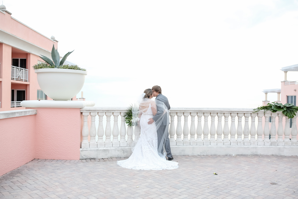 Florida Bride and Groom Waterfront Rooftop Balcony Wedding Portrait   Tampa Bay Wedding Photographer Lifelong Photography Studios   Hotel Wedding Venue Hyatt Regency Clearwater Beach