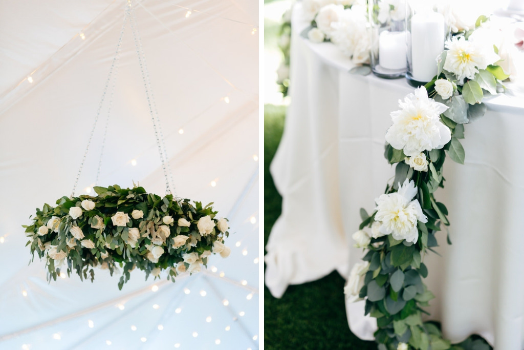 Elegant, Simple, Classic Garden Inspired Wedding Tent Reception Decor, Hanging Greenery and Ivory Floral Wreath, White Linen Table with Greenery Garland and White Flowers | Tampa Bay Wedding Rentals Gabro Event Services