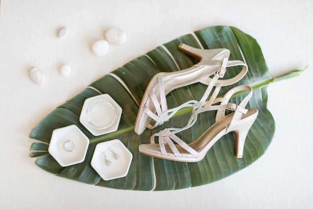 Tropical Elegant Wedding, Large Palm Tree Leaf With Wedding Accessories, Sparkle and Rhinestone Champagne Gold Sandal Wedding Shoes, Bridal Jewelry   Tampa Bay Wedding Photographer Lifelong Photography Studios