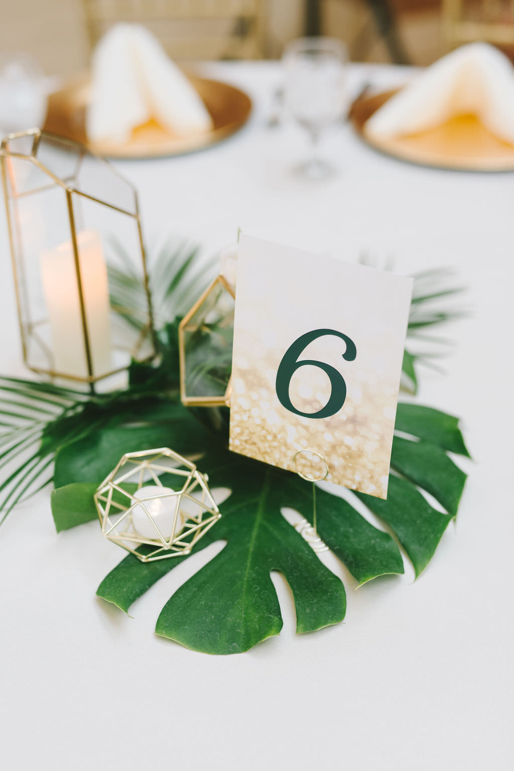 Modern Tropical Classic Wedding Reception Decor, Monstera Palm Tree Leaf Centerpiece with Geometric Candle Holders, White and Gold Cardstock Table Number   Wedding Photographer Kera Photography