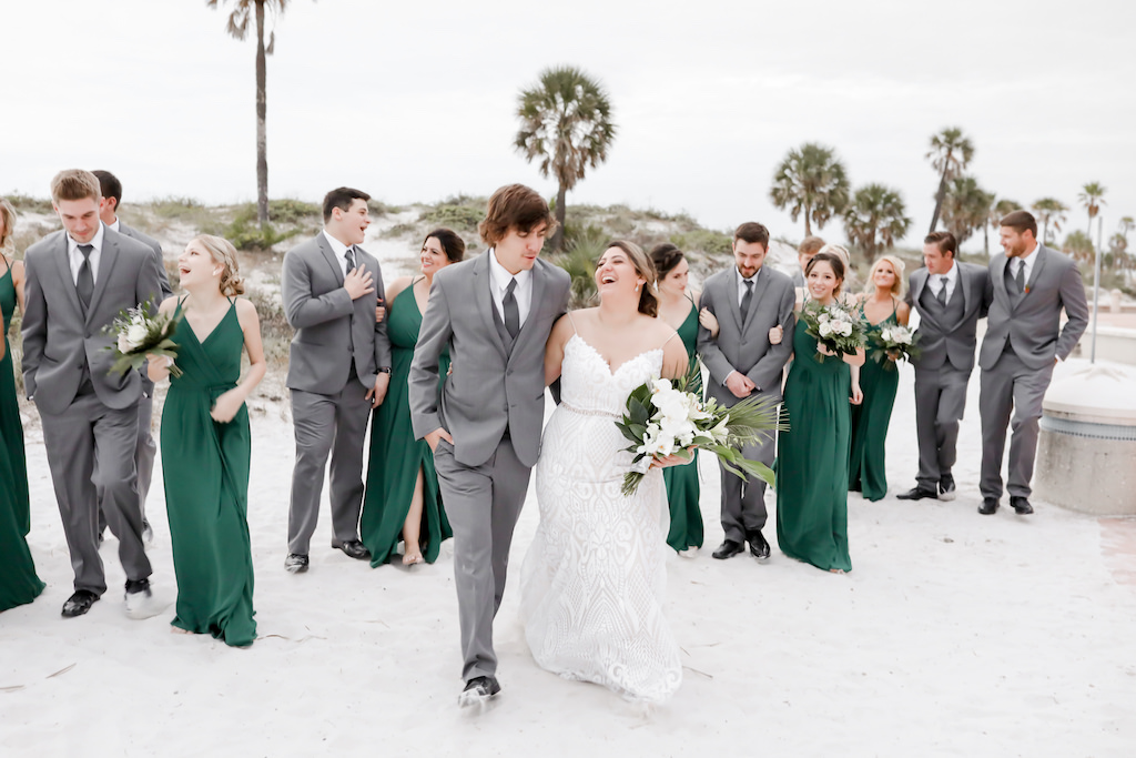 Florida Bride and Groom, Bridesmaids in Long Matching Green Dresses, Groomsmen in Grey Suits Fun Wedding Party Photo on Beach   Tampa Bay Wedding Photographer Lifelong Photography Studios