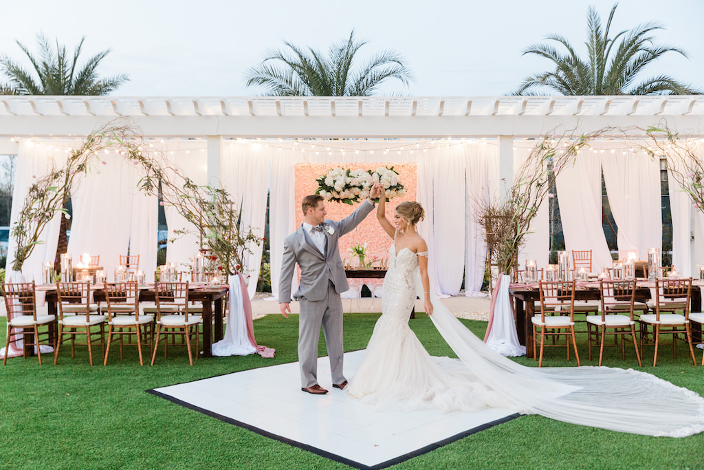 Romantic, Modern Florida Bride and Groom, Wearing White Couture Wedding Dress with Long Tulle Cape   Tampa Bay Hair and Makeup Artists Femme Akoi   Tampa Bay Couture Wedding Dress Boutique Isabel O'Neil Bridal Collection  