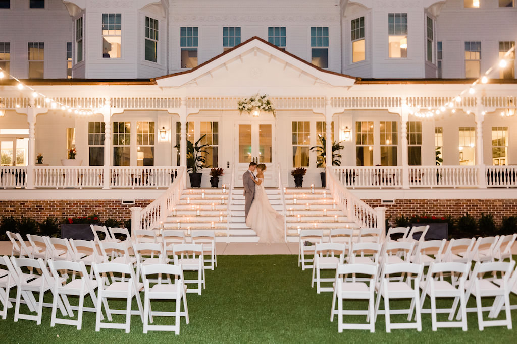 Romantic, Modern Florida Bride and Groom, Outdoor Candlelight Ceremony at Night, Front Lawn, Porch Steps of Historic Inn   Tampa Bay Wedding Planner Special Moments Event Planning   Tampa Bay Florist Gabro Event Services