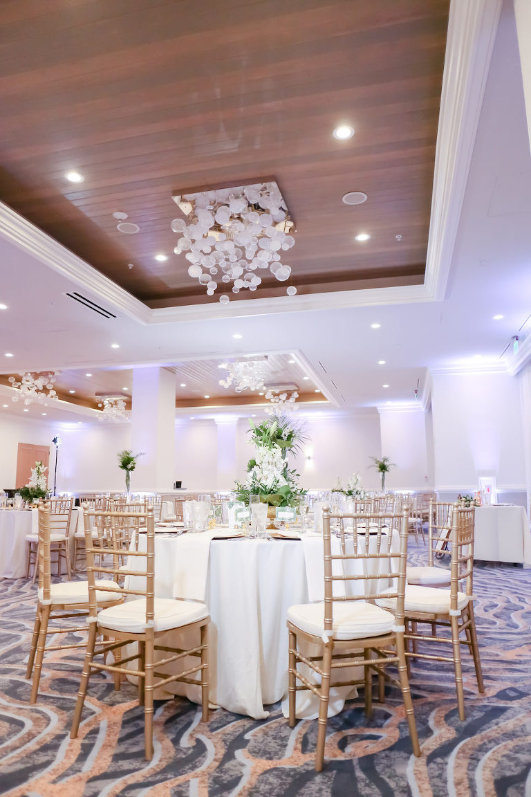 Florida Ballroom Tropical Elegance Wedding Reception Decor, Round Tables with White Linens, Gold Chiavari Chairs | Tampa Bay Wedding Photographer Lifelong Photography Studios | Hotel Waterfront Wedding Venue Hyatt Regency Clearwater Beach