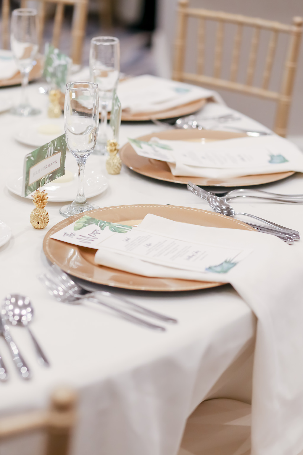 Tropical Elegance Wedding Reception Decor, White Linens, Gold Chargers, Tropical Stationery and Mini Gold Pineapple Accessory, Gold Chiavari Chairs   Tampa Bay Wedding Photographer Lifelong Photography Studios