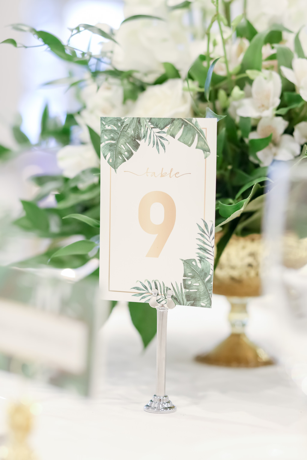 Tropical Elegance Wedding Reception Decor, Palm Leaves and Gold Table Number Signage Wedding Stationery   Tampa Bay Wedding Photographer Lifelong Photography Studios