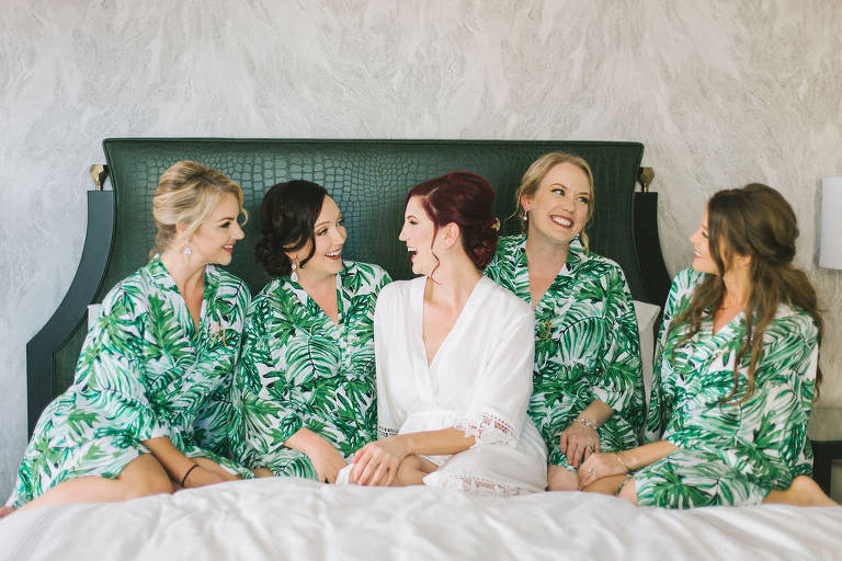 Florida Bride and Bridesmaids Getting Ready Hotel Suite Wedding Photo in Tropical Palm Tree Leaf Robes | Wedding Photographer Kera Photography | Tampa Bay Wedding Hair and Makeup Group Destiny and Light Hair and Makeup Group