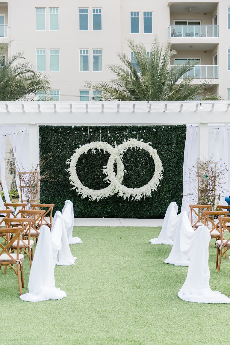 Modern, Garden Inspired Outdoor Wedding Ceremony, Gazebo Alter, Luxurious Infinity Ring Hanging Floral Arrangement with White Orchids, Dark Green Boxwood Wall, Wood Cross Back Chairs, Draping | Tampa Bay Wedding Planner Special Moments Event Planning | Tampa Bay Wedding Florist Gabro Event Services