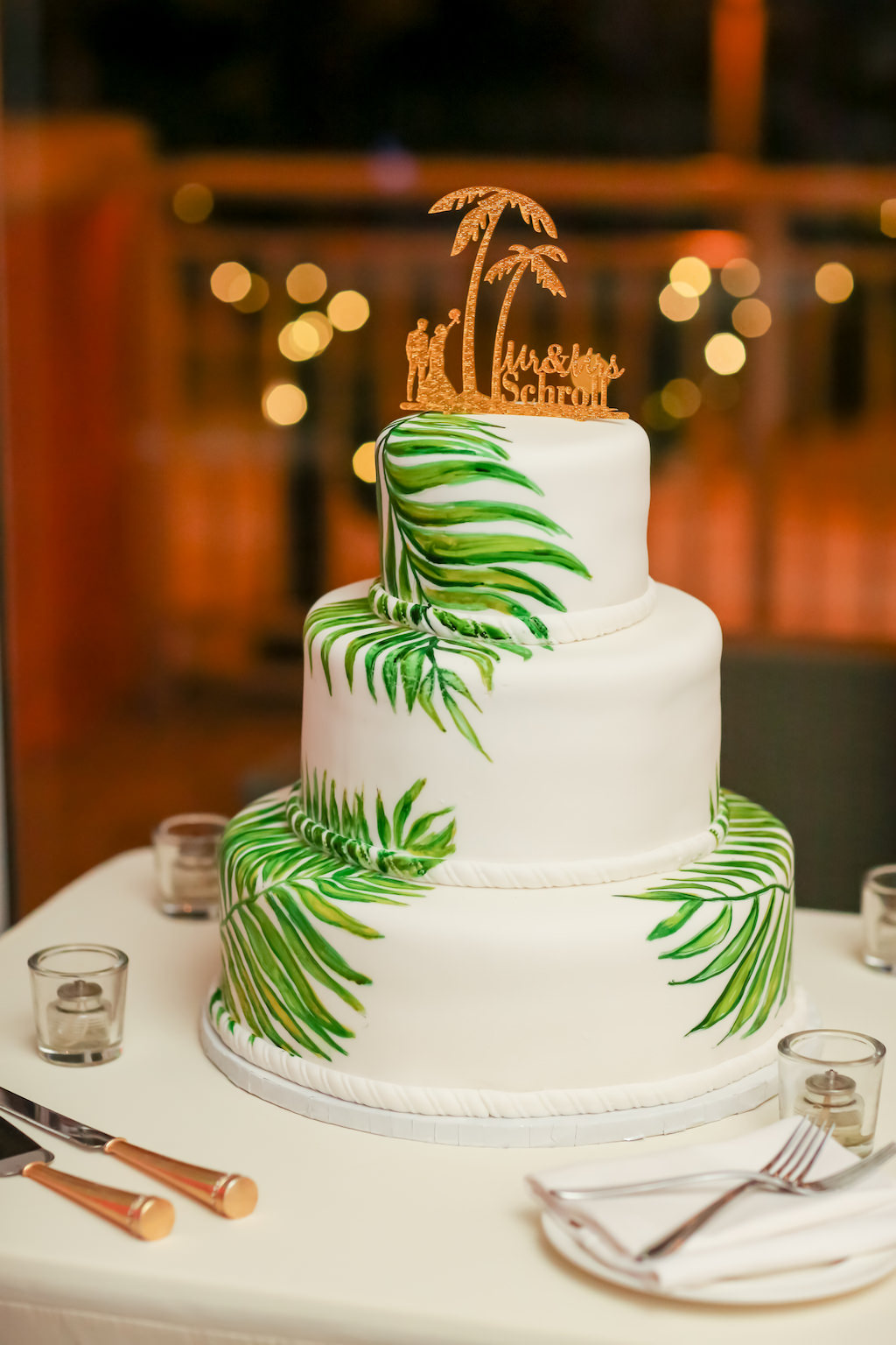 Tropical Inspired Smooth White with Painted Green Palm Leaves Wedding Cake with Custom Gold Cake Topper   Tampa Bay Wedding Photographer Lifelong Photography Studios