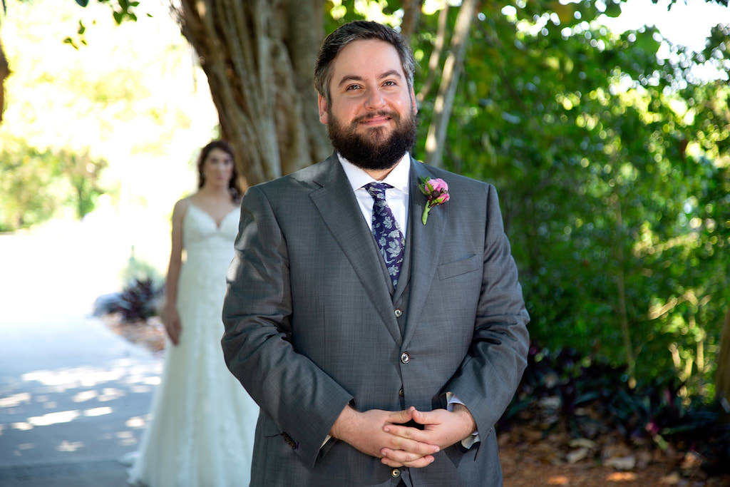 Outdoor Florida Bride and Groom First Look Wedding Portrait, Groom in Grey Suit with Navy Blue Paisley Pattern Tie and Pink Flower Boutonniere