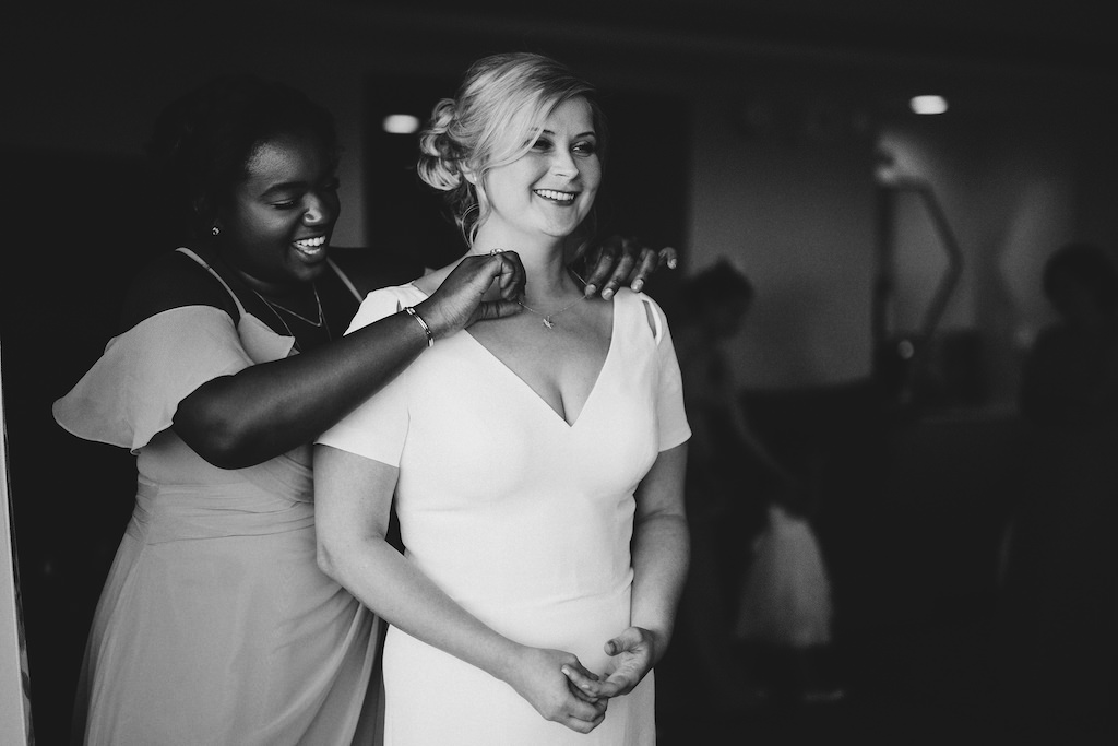 Florida Bride Getting Ready Black and White Wedding Photo in V Neckline With Sleeves Fitted Wedding Dress | Tampa Bay Wedding Hair and Makeup Femme Akoi