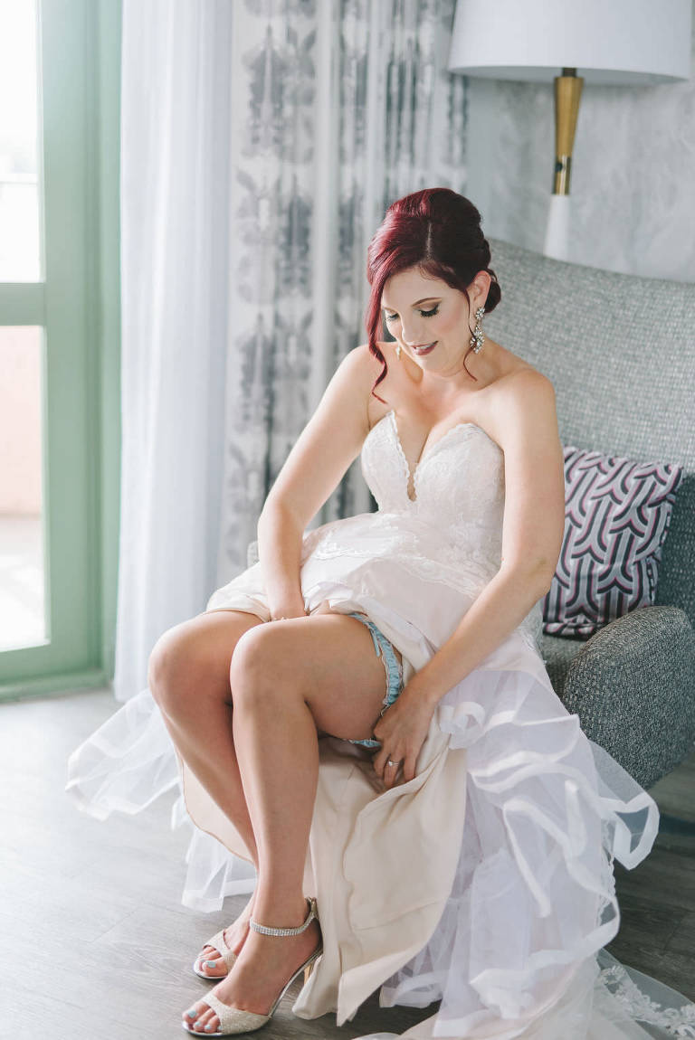 Tampa Bay Bride Getting Ready Wedding Portrait Putting on Something Blue Garter, Champagne Gold Nude Sandal Wedding Heel Shoes in Strapless Sweetheart Fit and Flare Formal Classic Lace Stella York Wedding Dress | Wedding Photographer Kera Photography | Destiny and Light Hair and Makeup Group