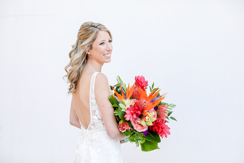 Elegant Florida Bride with Vibrant, Tropical Floral Bouquet, Colorful Island-Inspired Flowers Bridal Portrait | Tampa Bay Wedding Photographer Lifelong Photography Studios | Tampa Bay Wedding Hair and Makeup Artist Michele Renee The Studio