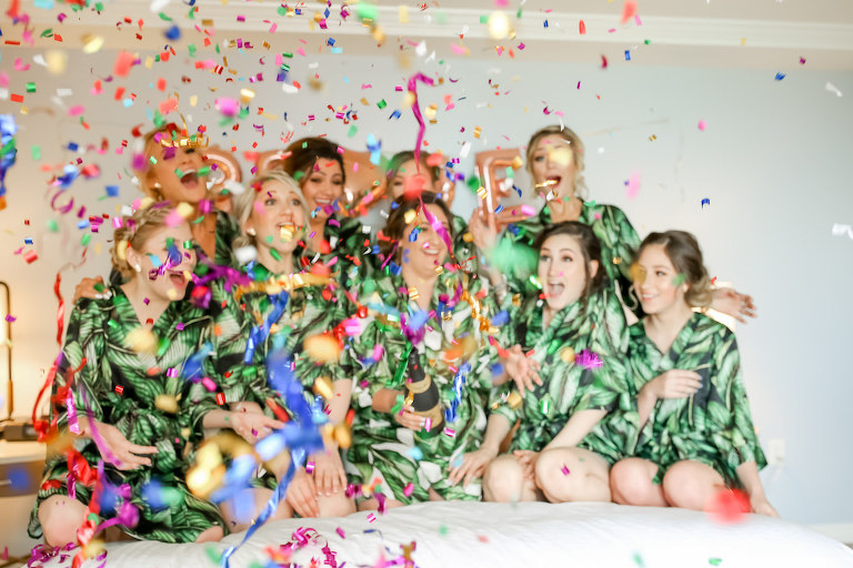 Florida Bride and Bridesmaids Getting Ready Confetti Wedding Portrait in Matching Tropical Robes and Champagne Bottle   Tampa Bay Wedding Photographer Lifelong Photography Studios