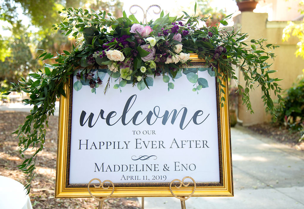 Sarasota Elegant, Classic Wedding Ceremony Decor, Gold Frame with White and Black Font Welcome Sign, Purple, Lilac, Ivory and Greenery Floral Arrangement