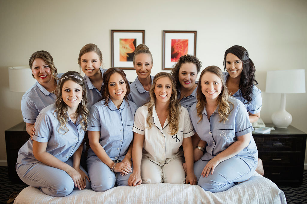 Classic Florida Bride and Bridesmaids in Matching Light Blue Custom Monogram Pajamas Getting Ready Hotel Wedding Portrait   Tampa Bay Wedding Hair and Makeup LDM Beauty Group