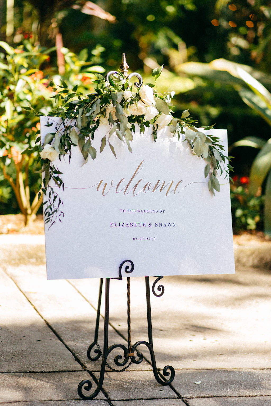 Simple Elegant Garden Inspired Wedding Ceremony White Welcome Sign with Greenery Garland and White Ivory Florals Decor