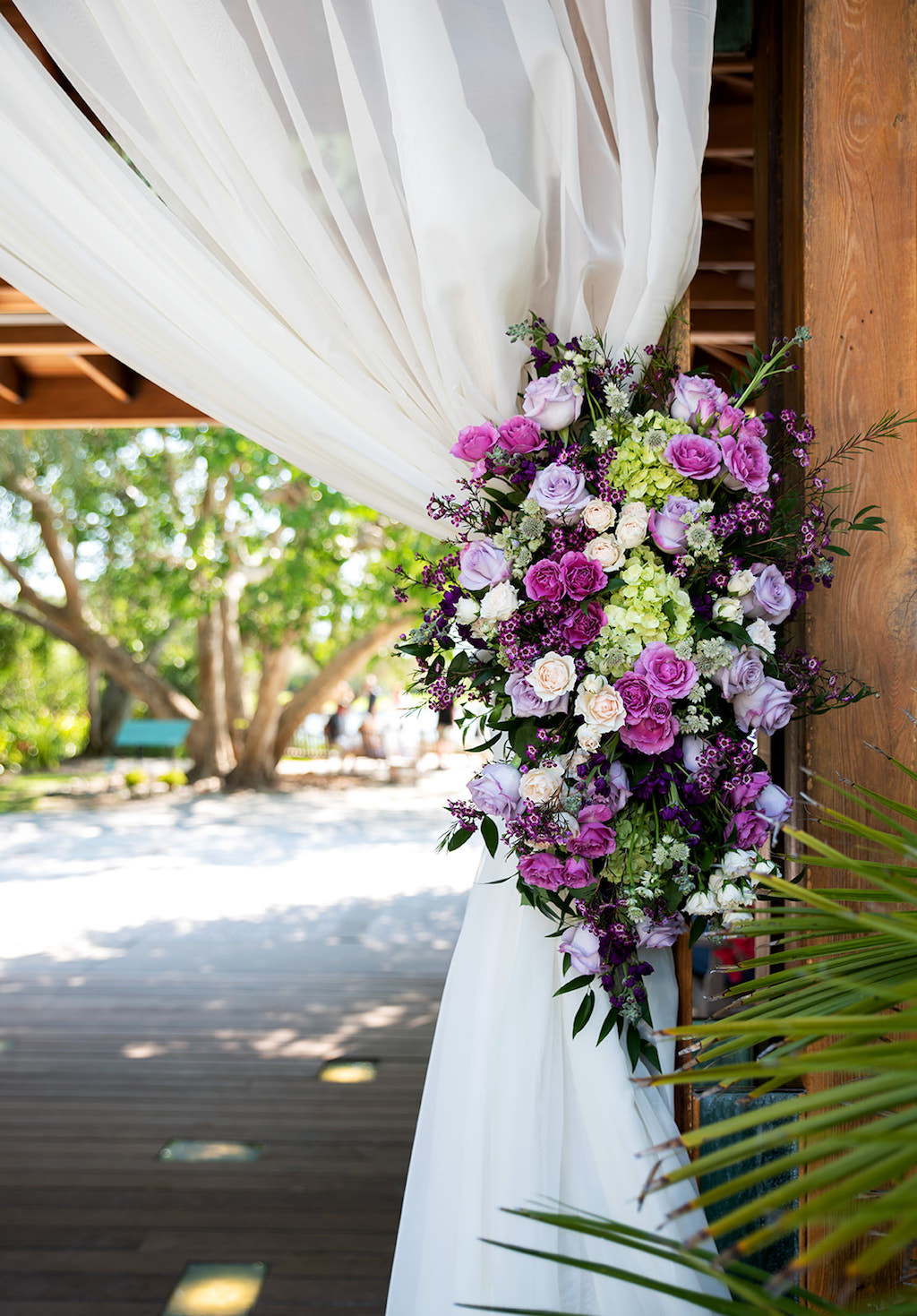 Sarasota Elegant, Classic Wedding Ceremony Decor, White Draping, Purple, Lilac Roses, Green Hydrangeas, Blush Pink and Greenery Floral Arrangement