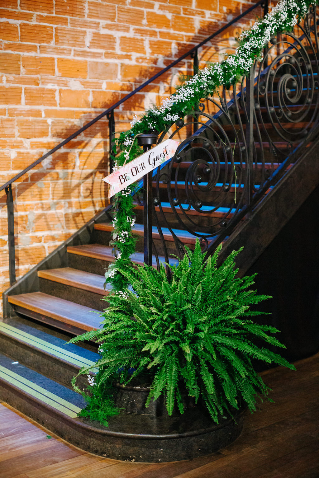 Modern, Romantic Reception and Florida Wedding Decor, Greenery Plant, Garland on Staircase with Babies Breath Florals | Tampa Bay Premier Wedding Venue NOVA 535 in Downtown St. Pete