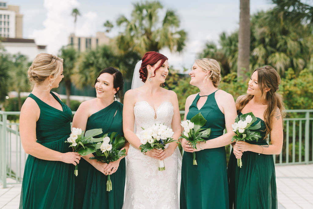 Florida Bride and Bridesmaid Wedding Portrait in Emerald Green Mix and Match Dresses, Bride in Strapless Sweetheart Formal Classic Lace Fit and Flare Stella York Wedding Dress Holding White, Ivory Tulip and Rose Floral Bouquet   Wedding Photographer Kera Photography   Destiny and Light Hair and Makeup Group