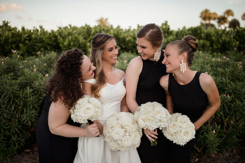 Classic, Formal Bride and Bridesmaids Wedding Portrait, Bridesmaids in Black Dresses and Bride in Calla Blanche Off the Shoulder White Wedding Dress Holding Traditional Round White, Ivory Rose Floral Bouquets   Tampa Bay Wedding Hair and Makeup LDM Beauty Group