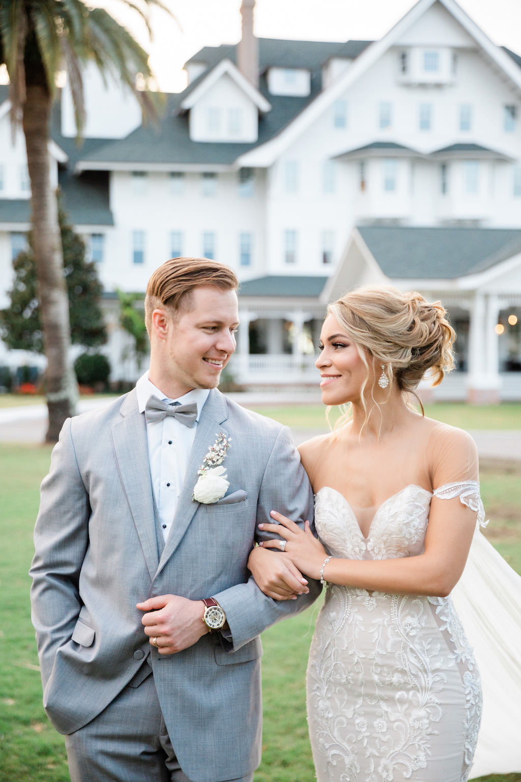 Romantic, Modern Florida Bride and Groom, Wearing White Fitted Mermaid Style Couture Wedding Dress, Light Gray Suite   Tampa Bay Hair and Makeup Artists Femme Akoi   Tampa Bay Couture Wedding Dress Boutique Isabel O'Neil Bridal Collection  