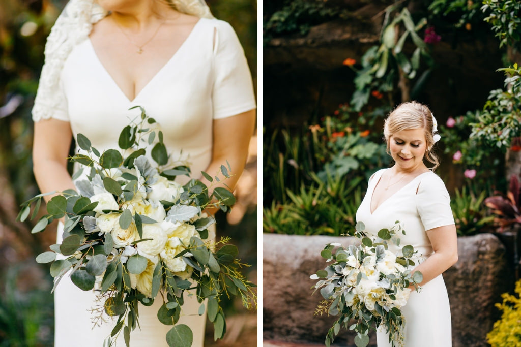 Classic Florida Bride Wedding Portrait in V Neckline with Sleeves Simple Fitted Wedding Dress Holding Organic Garden Silver Dollar Eucalyptus Greenery and Ivory Rose Floral Bouquet | Tampa Bay Wedding Hair and Makeup Femme Akoi